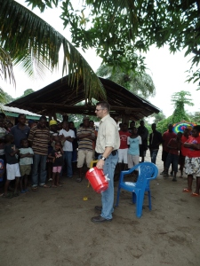 Using a bucket and cleaning kit as an illustration while sharing the gospel.