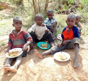 Kenyan Kids Eating on Ground
