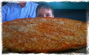 Nathan Behind a Huge Pizza